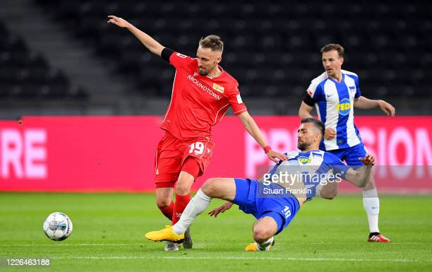 Vedad Ibisevic of Hertha Berlin challenges Florian Huebner of Union Berlin during the Bundesliga match between Hertha BSC and 1 FC Union Berlin at...