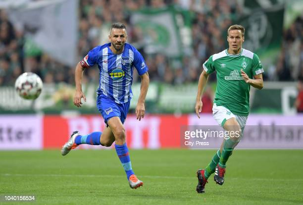 Vedad Ibisevic of Hertha BSC and Niklas Moisander of Werder Bremen during the Bundesliga match between SV Werder Bremen and Hertha BSC at...