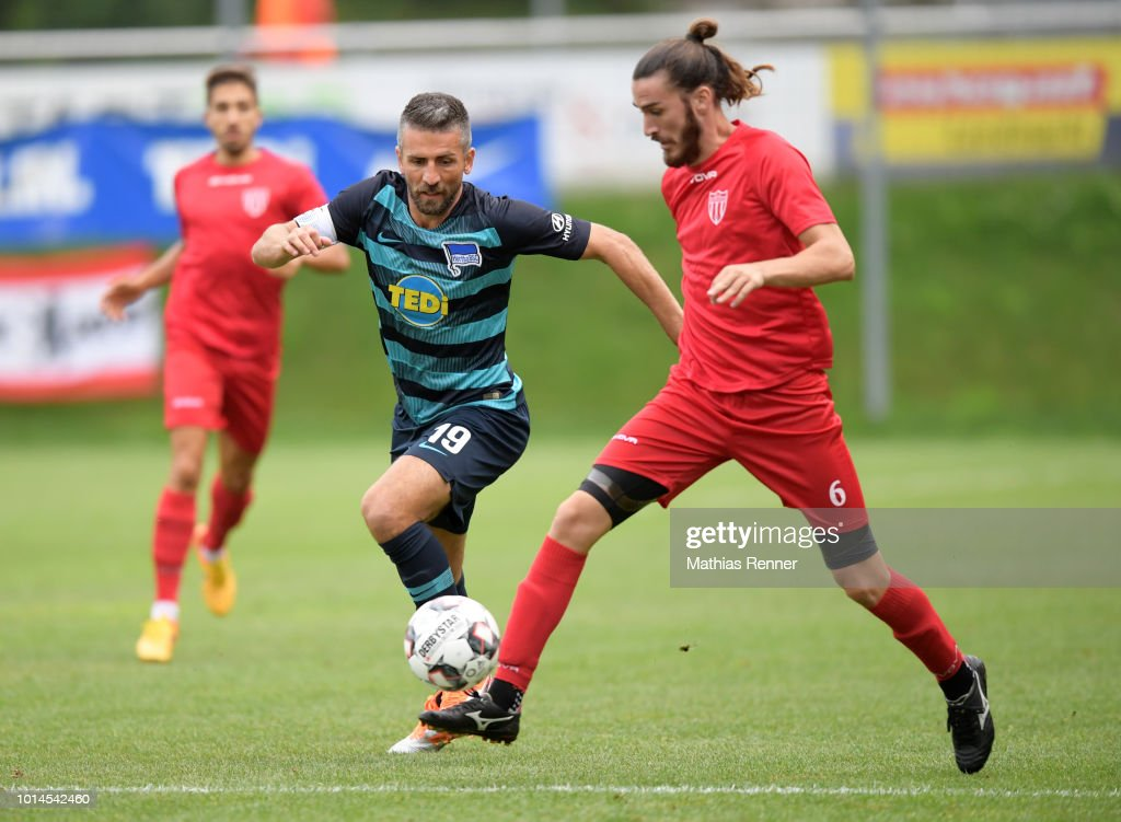 Vedad Ibisevic of Hertha BSC and Pavlos Laskaris of Aiginiakos FC during the test test match between Hertha BSC and Aiginiakos FC at the Athletic Area Schladming on august 10, 2018 in Schladming, Austria.