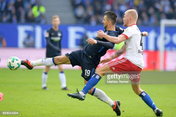 Vedad Ibisevic of Hertha BSC and Rick van Drongelen of Hamburger SV during the Bundesliga game between Hamburger SV and Hertha BSC at...