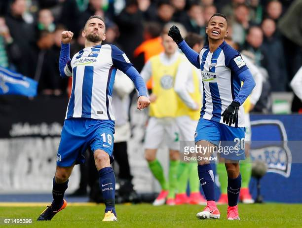 Vedad Ibisevic of Hertha BSC celebrates with team mate Allan of Hertha BSC after scoring his team's first goal during the Bundesliga match between...