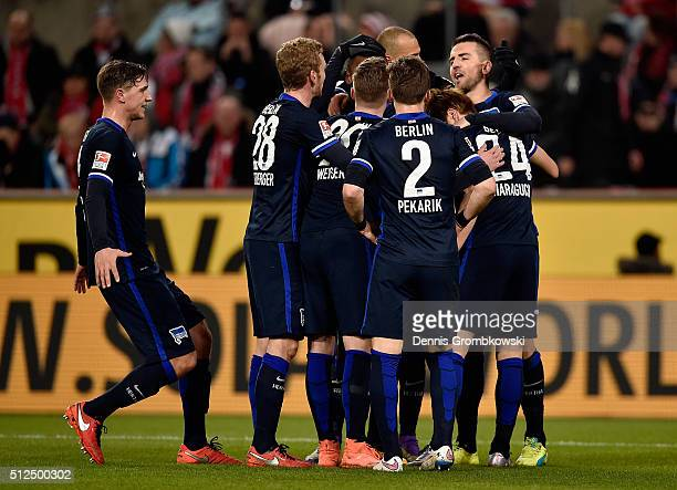 Vedad Ibisevic of Hertha BSC celebrates with team mates as he scores the opening goal during the Bundesliga match between 1 FC Koeln and Hertha BSC...