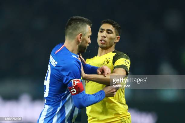Vedad Ibisevic of Hertha BSC clashes with Achraf Hakimi of Borussia Dortmund during the Bundesliga match between Hertha BSC and Borussia Dortmund at...