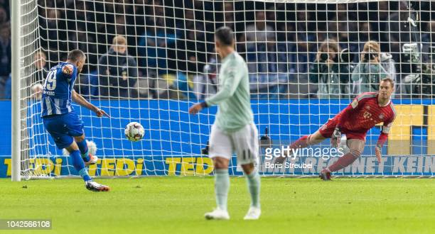 Vedad Ibisevic of Hertha BSC scores his team's first goal by penalty against goalkeeper Manuel Neuer of FC Bayern Muenchen during the Bundesliga...