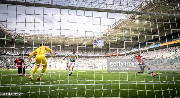 Vedad Ibisevic of Hertha BSC shoots to score a goal to make it 21 during the Bundesliga match between Borussia Moenchengladbach and Hertha BSC at...