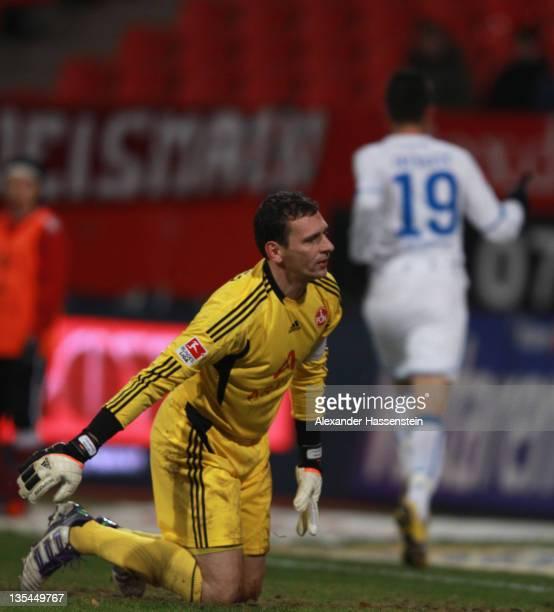 Vedad Ibisevic of Hoffenheim celebrates scoring the 2nd team goal whilst Raphael Schaefer, keeper of Nurenberg looks dejected during the Bundesliga...