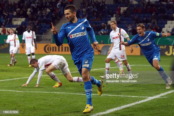 Vedad Ibisevic of Hoffenheim celebrates scoring the second team goal during the DFB Cup round of sixteen match between TSV 1899 Hoffenheim and FC...