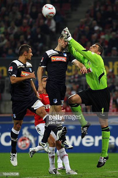 Vedad Ibisevic of Hoffenheim is challenged by goalkeeper Faryd Mondragon of Koeln during the Bundesliga match between 1 FC Koeln and 1899 Hoffenheim...