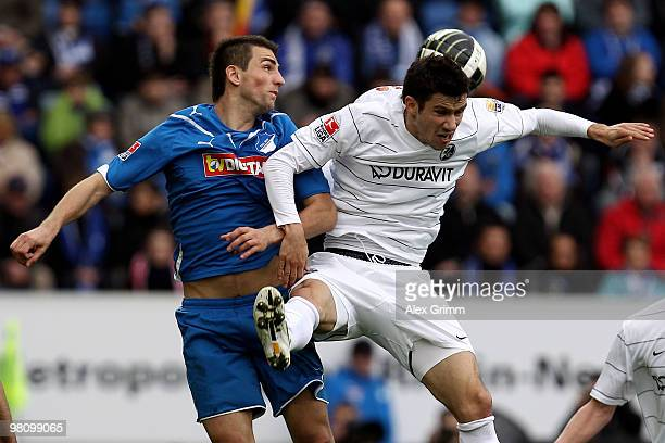 Vedad Ibisevic of Hoffenheim jumps for a header with Mensur Mujdza of Freiburg during the Bundesliga match between 1899 Hoffenheim and SC Freiburg at...