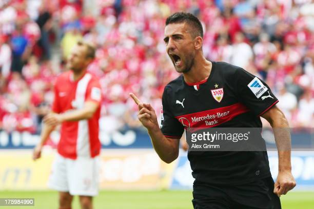 Vedad Ibisevic of Stuttgart celebrates his team's first goal during the Bundesliga match between 1. FSV Mainz 05 and VfB Stuttgart at Coface Arena on...