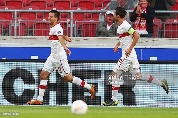 Vedad Ibisevic of Stuttgart celebrates his team's first goal with team mate Christian Gentner during the UEFA Europa League group E match between VfB...