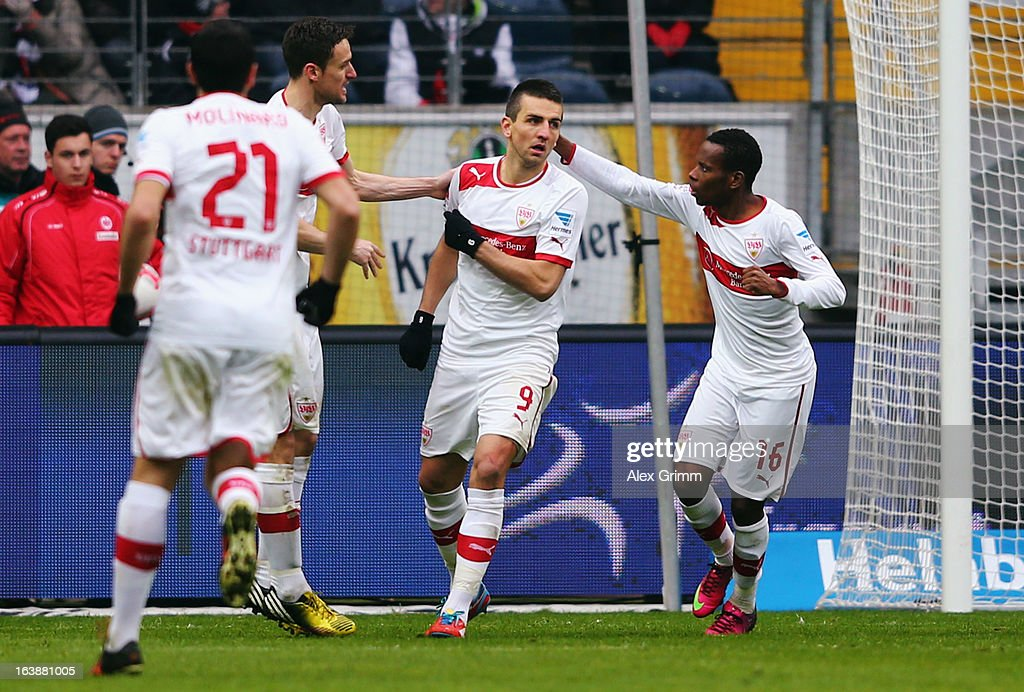 Vedad Ibisevic (2R) of Stuttgart celebrates his team's first goal with team mates Ibrahima Traore (R), Christian Gentner and Cristian Molinaro (front) during the Bundesliga match between Eintracht Frankfurt and VfB Stuttgart at Commerzbank-Arena on March 17, 2013 in Frankfurt am Main, Germany.
