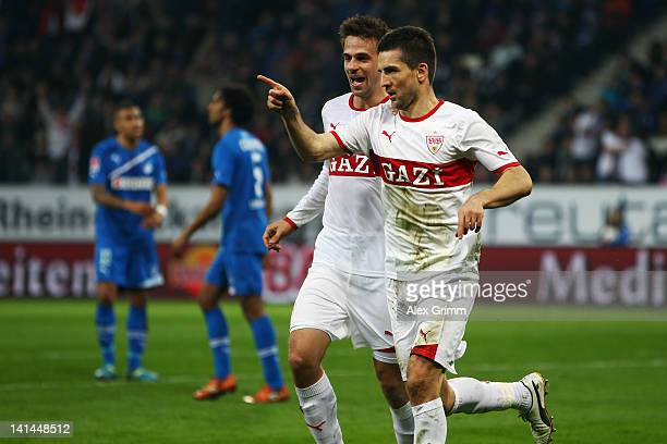 Vedad Ibisevic of Stuttgart celebrates his team's second goal with team mate Martin Harnik during the Bundesliga match between 1899 Hoffenheim and...