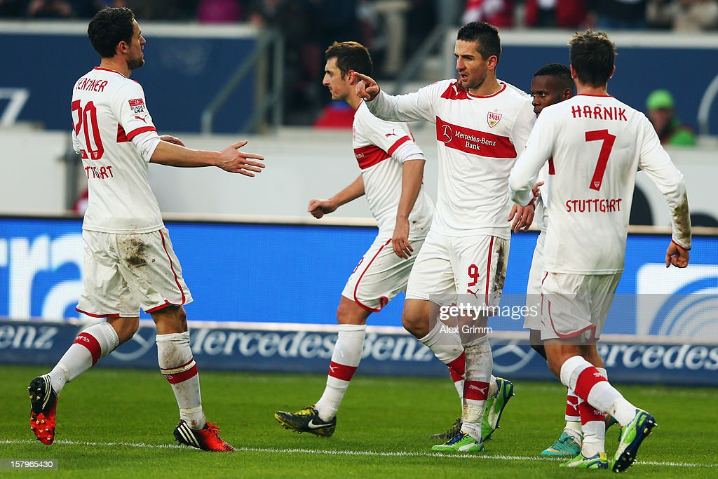 Vedad Ibisevic (2R) of Stuttgart celebrates his team's second goal with team mates during the Bundesliga match between VfB Stuttgart and FC Schalke 04 at Mercedes-Benz Arena on December 8, 2012 in Stuttgart, Germany.