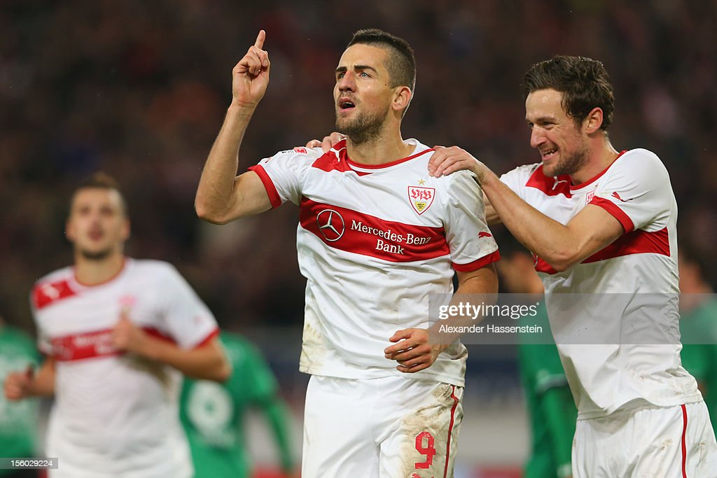 Vedad Ibisevic (C) of Stuttgart celebrates scoring the 2nd team goal with his team mate Christian Gentner (R), who scores the first team goal during the Bundesliga match between VfB Stuttgart and Hannover 96 at Mercedes-Benz Arena on November 11, 2012 in Stuttgart, Germany.