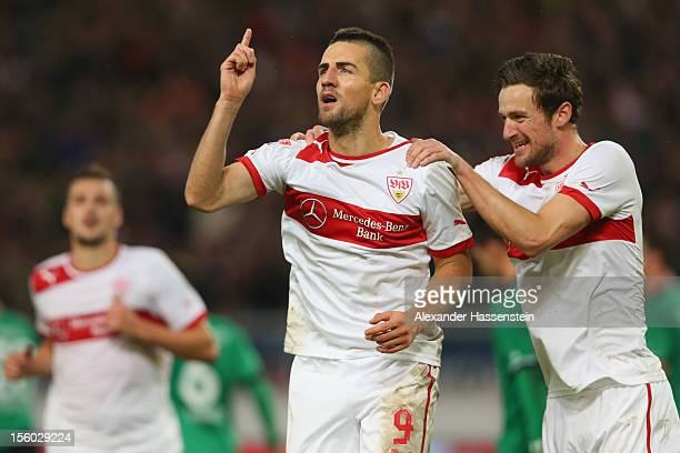 Vedad Ibisevic of Stuttgart celebrates scoring the 2nd team goal with his team mate Christian Gentner who scores the first team goal during the...