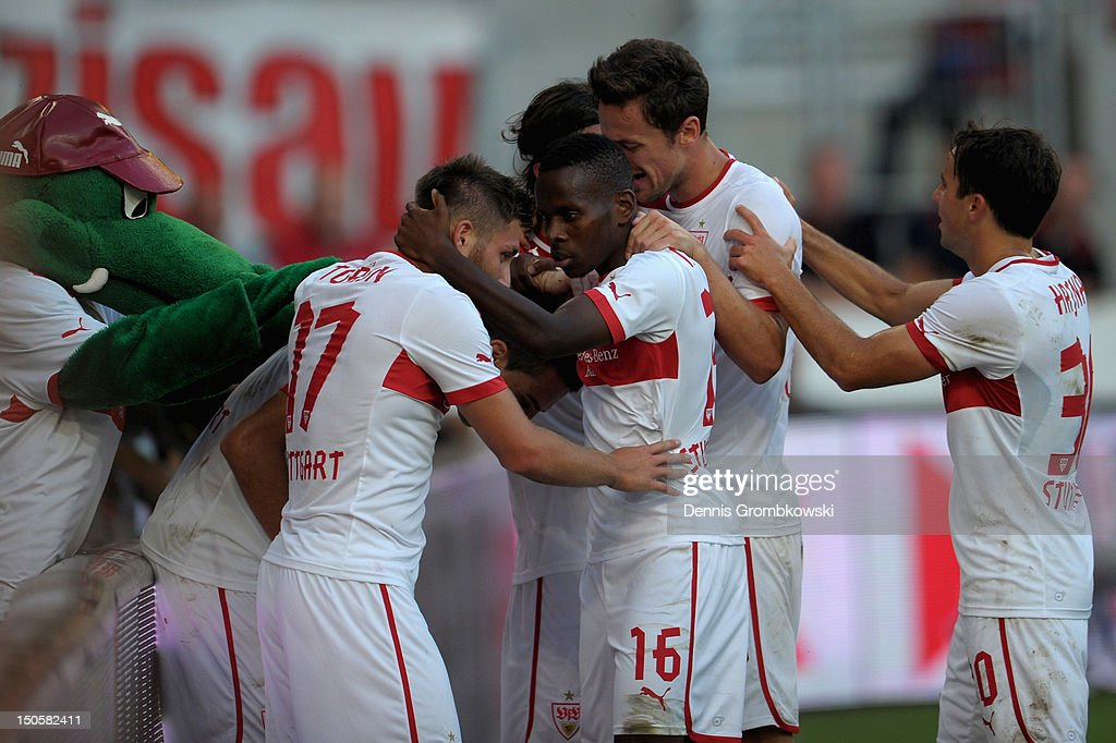 Vedad Ibisevic of Stuttgart celebrates with teammates after scoring his team's first goal during the UEFA Europa League Qualifying Play-Off match between VfB Stuttgart and FC Dynamo Moscow at Mercedes-Benz Arena on August 22, 2012 in Stuttgart, Germany.