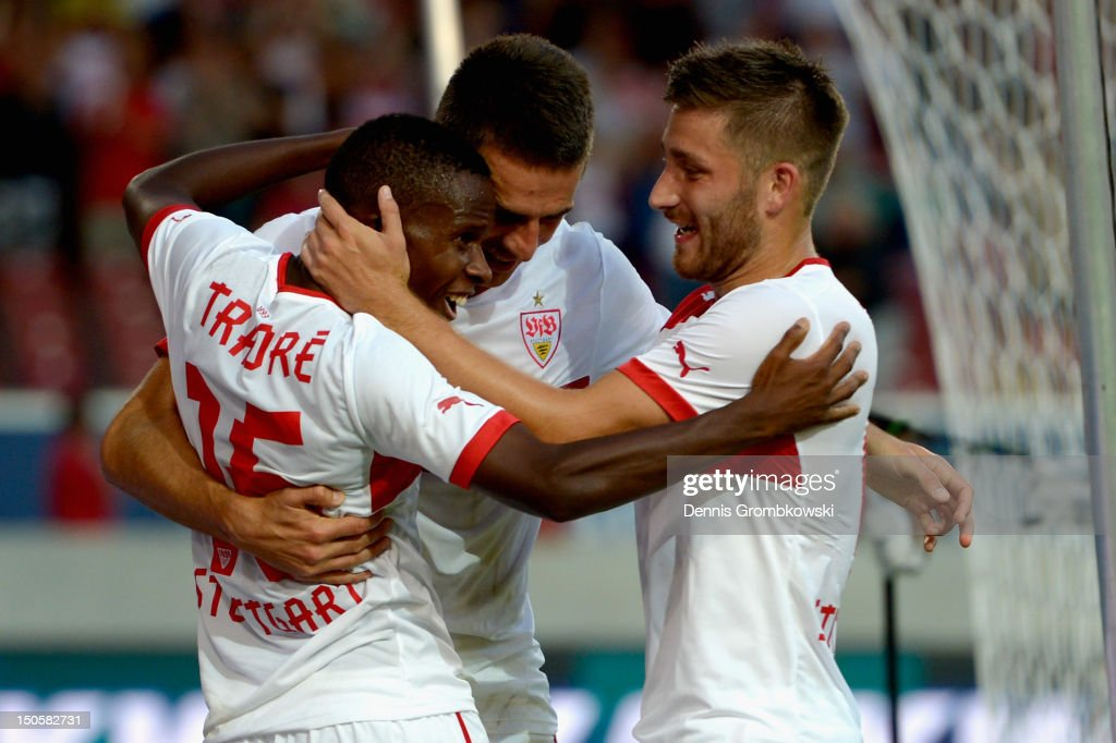 Vedad Ibisevic of Stuttgart celebrates with teammates Ibrahima Traore and Tunay Torun after scoring his team's second goal during the UEFA Europa League Qualifying Play-Off match between VfB Stuttgart and FC Dynamo Moscow at Mercedes-Benz Arena on August 22, 2012 in Stuttgart, Germany.