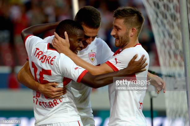 Vedad Ibisevic of Stuttgart celebrates with teammates Ibrahima Traore and Tunay Torun after scoring his team's second goal during the UEFA Europa...