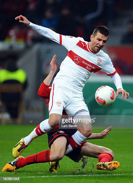 Vedad Ibisevic of Stuttgart is challenged by Daniel Schwaab of Leverkusen during the Bundesliga match between Bayer 04 Leverkusen and VfB Stuttgart...