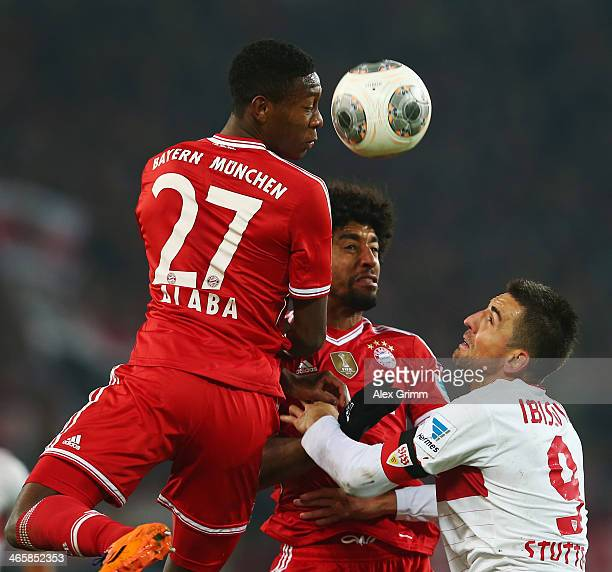 Vedad Ibisevic of Stuttgart is challenged by Dante and David Alaba of Muenchen during the Bundesliga match between VfB Stuttgart and FC Bayern...