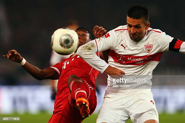 Vedad Ibisevic of Stuttgart is challenged by David Alaba of Muenchen during the Bundesliga match between VfB Stuttgart and FC Bayern Muenchen at...