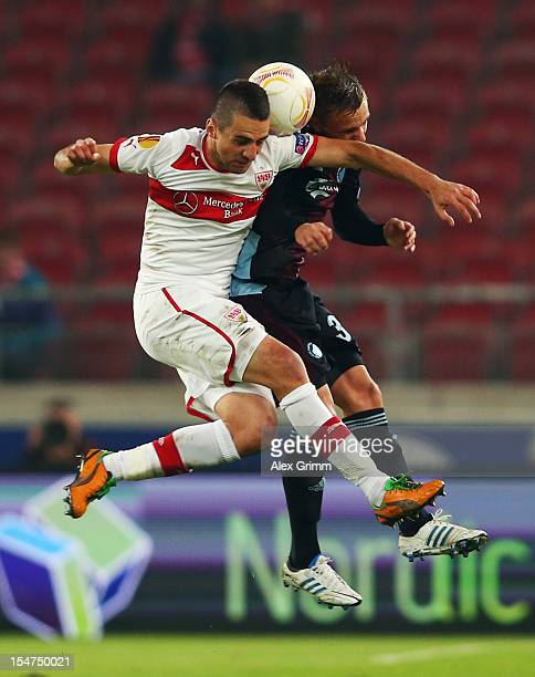 Vedad Ibisevic of Stuttgart is challenged by Pierre Bengtsson of Copenhagen during the UEFA Europa League group E match between VfB Stuttgart and FC...