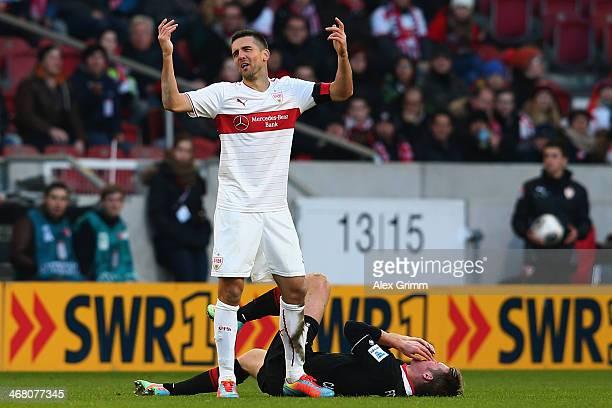 Vedad Ibisevic of Stuttgart reacts next to Jan-Ingwer Callsen-Bracker of Augsburg before being sent off during the Bundesliga match between VfB...