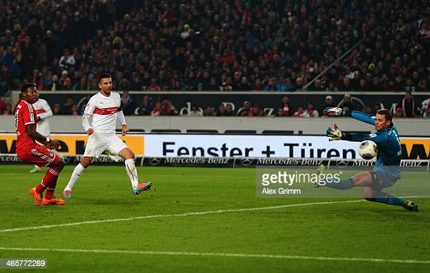 Vedad Ibisevic of Stuttgart scores his team's first goal against David Alaba and goalkeeper Manuel Neuer of Muenchen during the Bundesliga match...
