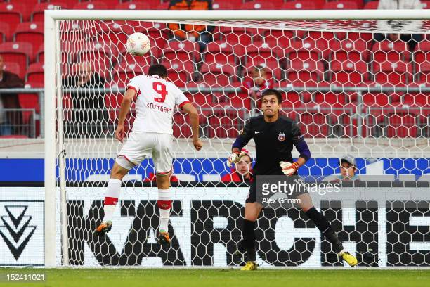 Vedad Ibisevic of Stuttgart scores his team's first goal against goalkeeper Ciprian Tatarusanu of Bucuresti during the UEFA Europa League group E...