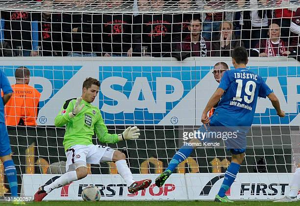 Vedad Ibisevic, R, of Hoffenheim scores the opening goal past goalkeeper Kevin Trapp of Kaiserslautern during the Bundesliga match between 1899...