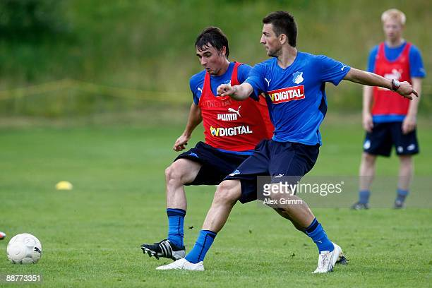 Vedad Ibisevic shoots a ball ahead of Christian Eichner during a training session of 1899 Hoffenheim during a training camp on July 1, 2009 in...
