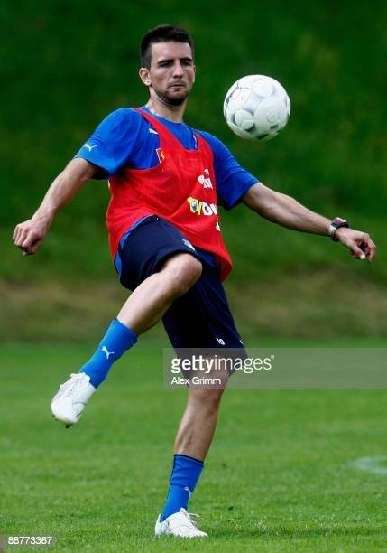 Vedad Ibisevic shoots a ball during a training session of 1899 Hoffenheim during a training camp on July 1, 2009 in Stahlhofen am Wiesensee, Germany.