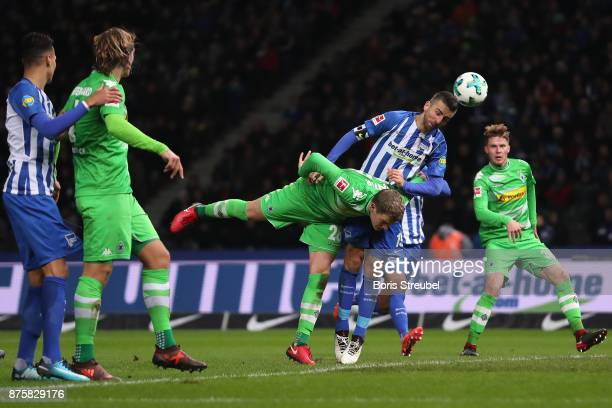Vedad Ibisevic of Berlin heads the ball against Matthias Ginter of Moenchengladbach during the Bundesliga match between Hertha BSC and Borussia...