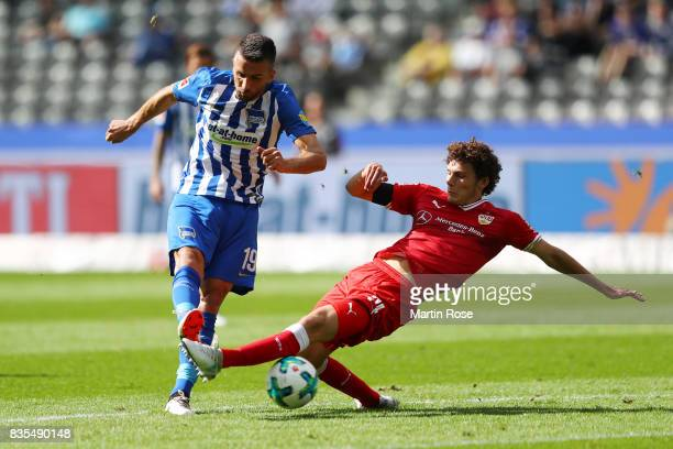 Vedad Ibisevic of Hertha BSC Berlin with Benjamin Pavard of VfB Stuttgart during the Bundesliga match between Hertha BSC and VfB Stuttgart at...
