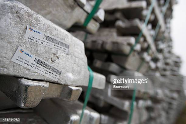 Vedanta Resources Plc stickers are displayed on stacked aluminum ingots at the Public Procurement Service warehouse in Gunsan South Korea on...