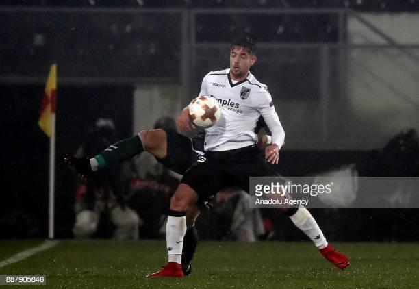 Vedat Bora of Atiker Konyaspor in action against Joao Vigario of Vitoria Guimaraes during UEFA Europa League Group I soccer match between Vitoria...