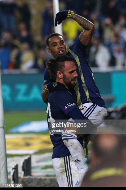 Vedat Muriqi and Garry Rodrigues of Fenerbahce celebrate after scoring a goal during the Turkish Super Lig week 19 soccer match between Fenerbahce...