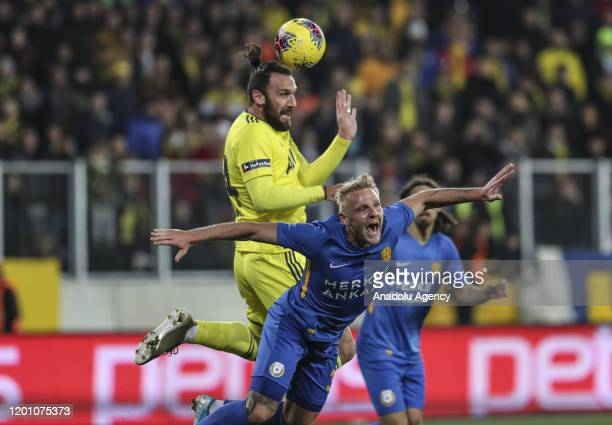 Vedat Muriqi of Fenerbahce and Daniel Lukasik of MKE Ankaragucu vie for the ball during the Turkish Super Lig week 22 soccer match between MKE...
