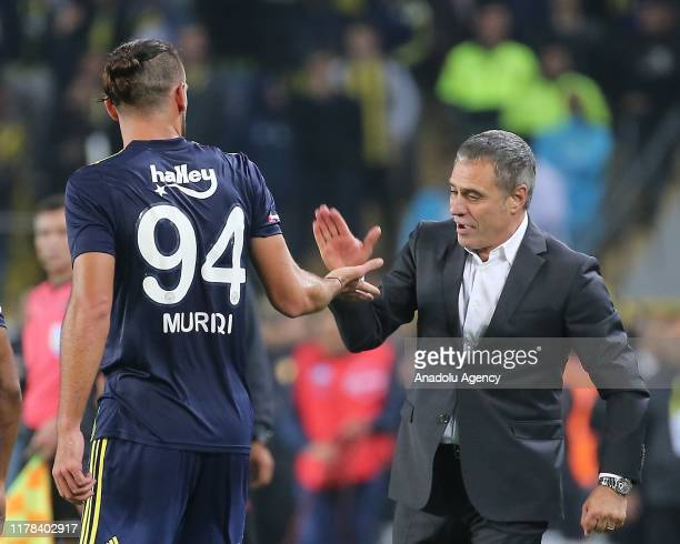 Vedat Muriqi of Fenerbahce celebrates after scoring a goal with his head coach Ersun Yanal during the Turkish Super Lig match between Fenerbahce and...
