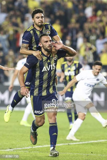 Vedat Muriqi of Fenerbahce celebrates with Ozan Tufan after scoring a goal during the Turkish Super Lig soccer match between Fenerbahce and Kasimpasa...