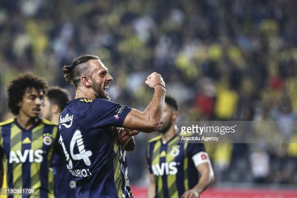 Vedat Muriqi of Fenerbahce celebrates with Ozan Tufan and Victor Moses after scoring a goal during the Turkish Super Lig soccer match between...