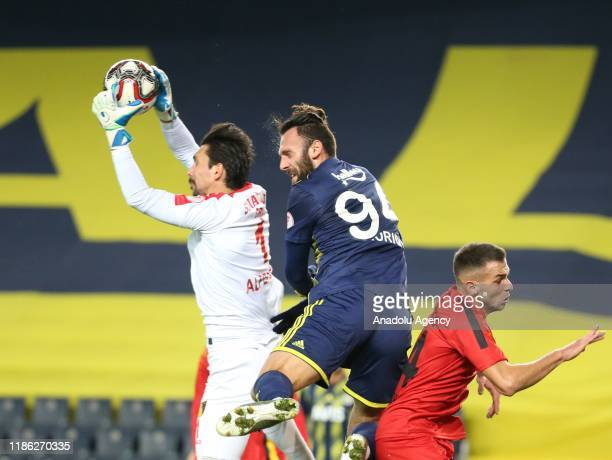 Vedat Muriqi of Fenerbahce in action against Alperen Uysal of Istanbulspor during Ziraat Turkish Cup 5th round soccer match between Fenerbahce and...