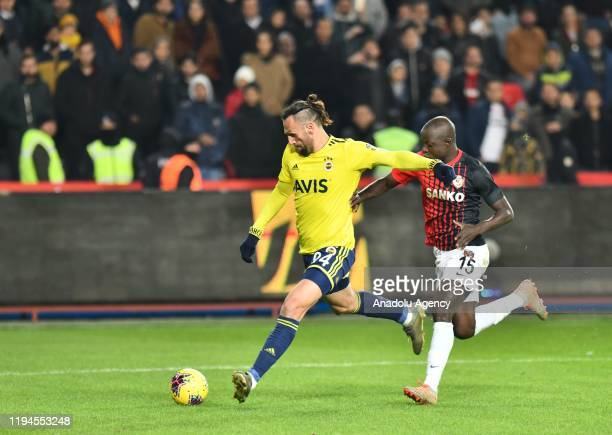 Vedat Muriqi of Fenerbahce in action against Chibsah of Gaziantep FK during the Turkish Super Lig week 18 football match between Gaziantep FK and...