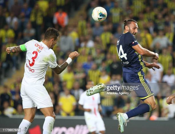 Vedat Muriqi of Fenerbahce in action against Diego Angelo of Antalyaspor during the Turkish Super Lig soccer match between Fenerbahce and Antalyaspor...