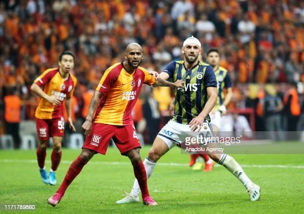 Vedat Muriqi of Fenerbahce in action against Marcao of Galatasaray during the Turkish Super Lig soccer match between Galatasaray and Fenerbahce at...