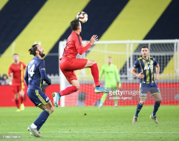 Vedat Muriqi of Fenerbahce in action against Oguzhan Berber of Istanbulspor during Ziraat Turkish Cup 5th round soccer match between Fenerbahce and...