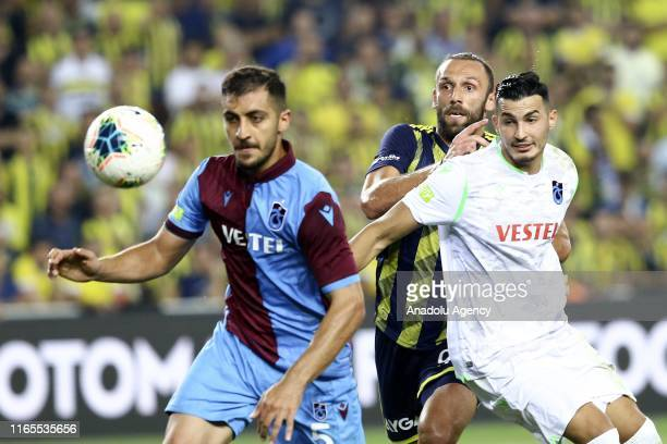 Vedat Muriqi of Fenerbahce in action against Ugurcan Cakir and Majid Hosseini of Trabzonspor during Turkish Super Lig week 3 match between Fenerbahce...