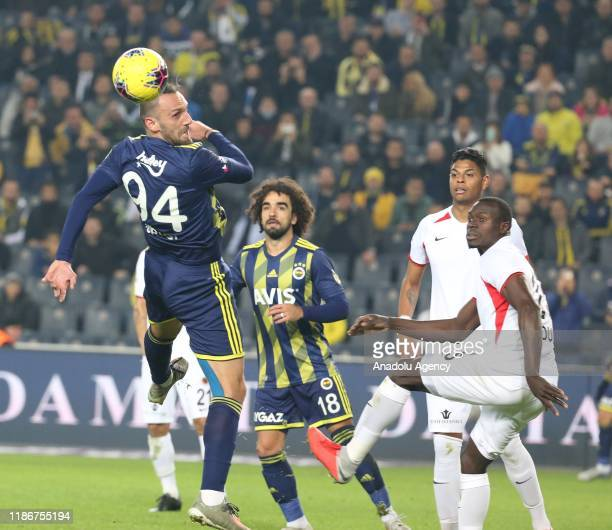 Vedat Muriqi of Fenerbahce in action against Zargo Toure of Genclerbirligi during the Turkish Super Lig week 14 soccer match between Fenerbahce and...