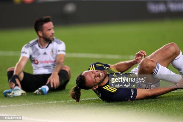 Vedat Muriqi of Fenerbahce is seen after an injury during the Turkish Super Lig soccer match between Fenerbahce and Besiktas in Istanbul Turkey on...